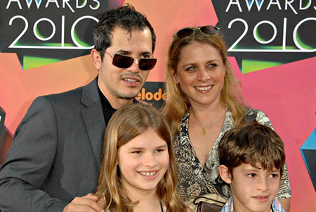 Happy family: John Leguizamo and Justine Maurer with their children: a son and a daughter