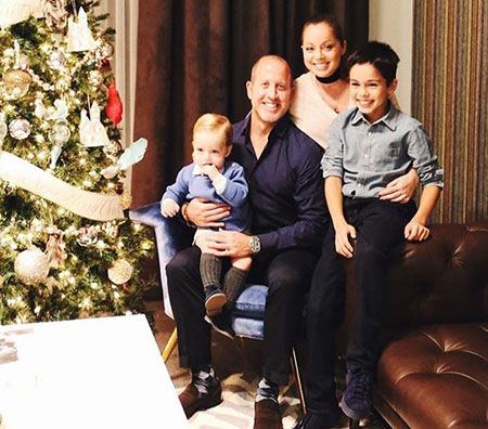 Marcela Valladolid and Philip D. Button with two sons