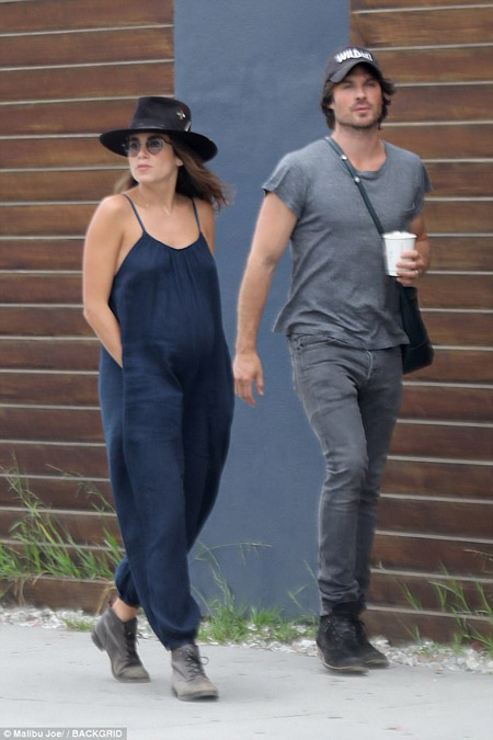 Proud married couple: Nikki Reed and Ian Somerhandler strolling on street