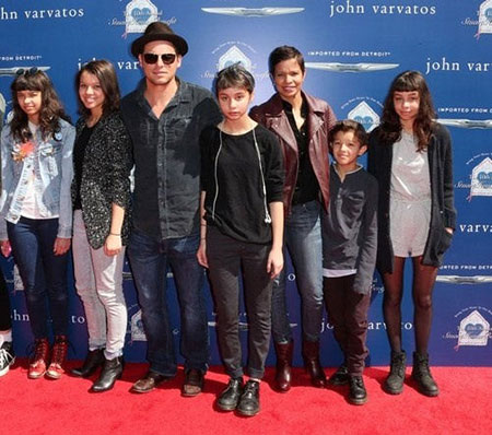 Perfect family: Justin Chambers with his wife Keisha and five children: a son and four daughters