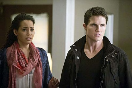 Robbie Amell and Madeleine Mantock