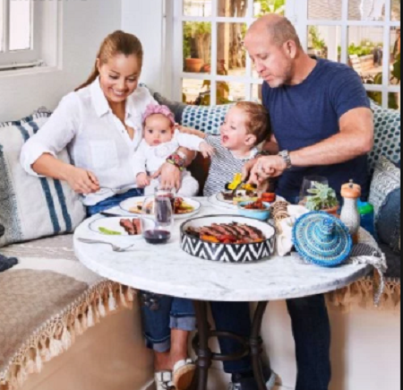 Marcela Valladolid and Philip Button with their children