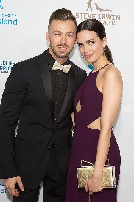 Torrey DeVitto and Artem Chigvintsev in an event