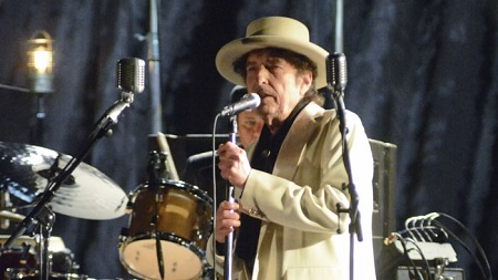 Bob Dylan performing in a concert
