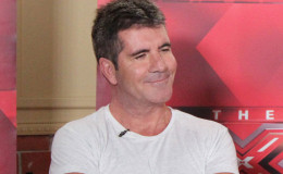 Simon Cowell Steps Out Into Stormy Rain Wearing Just A White T-Shirt